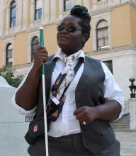Photo of a blind woman on a legislative visit.